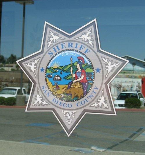 San Diego County Sheriff emblem.