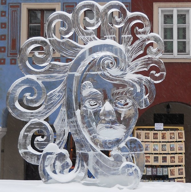 Ice Sculpture Gallery in Poznan: Mizula and Girault Won First Prize (near merchants' houses on the Old Market Square eastern side). Every year the International Ice Sculpture Festival attracts the most famous artists from around the world. There were Santa Claus, Christmas trees, and reindeer ice figures around the Old Market. The International Ice Sculpture Festival, the largest event of its kind in Europe started here on 8 December 2012. The sculpture Polish - French duo Michael Mizula - Samuel Girault has been recognized as the most outstanding. Their icy work of art presented a human face carved with fancy hair.