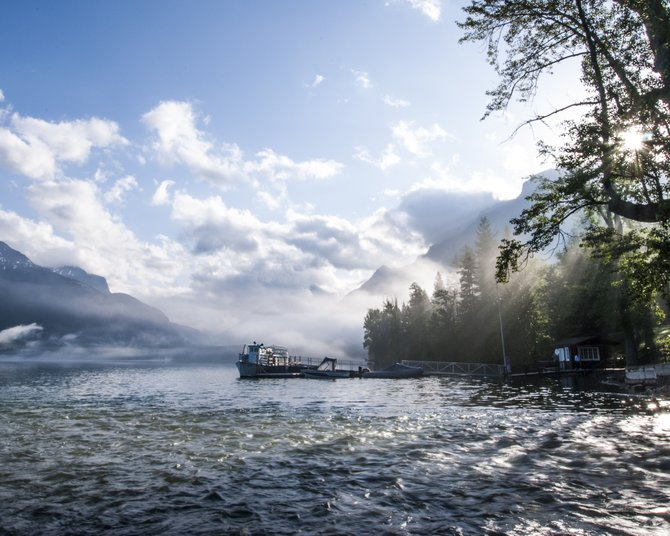 Fog lifting off Lake McDonald in Glacier National Park.
