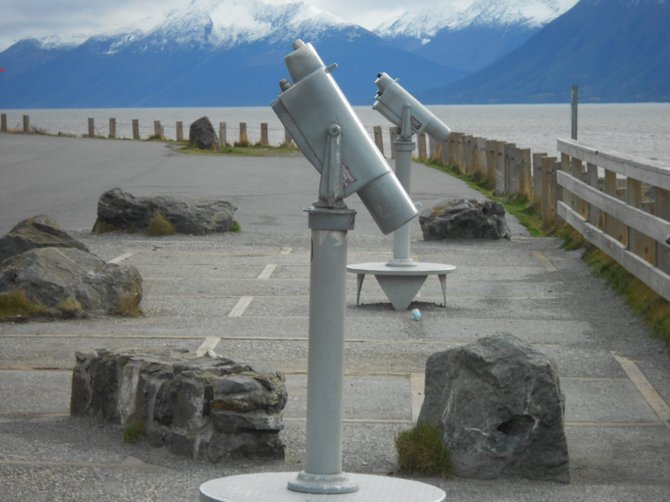 Telescopes line Beluga Point lookout outside of Anchorage, Alaska.