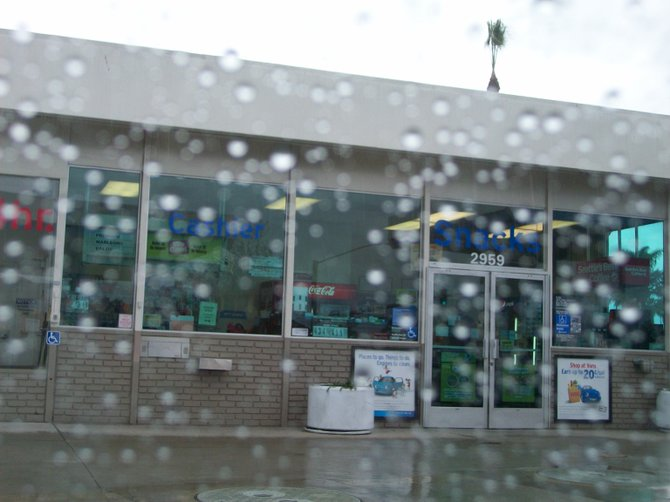 Chevron Gas Station in the rain in the Midway District.