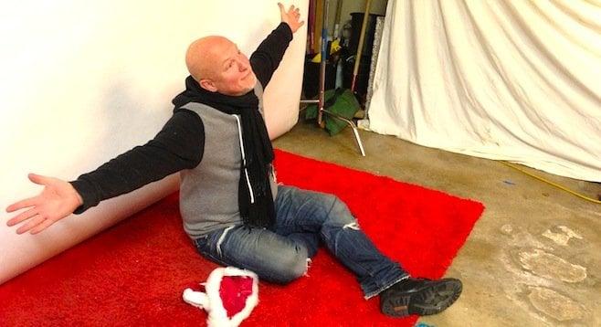 David, posing for the camera at a holiday party