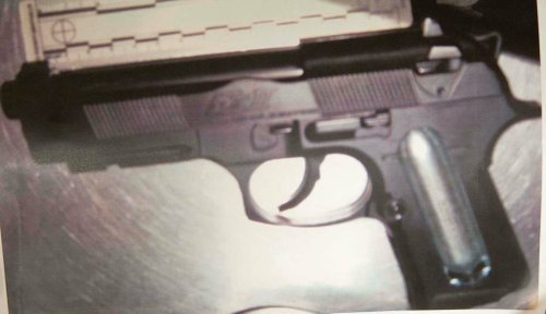Evidence photo of handgun used during attempted robbery.