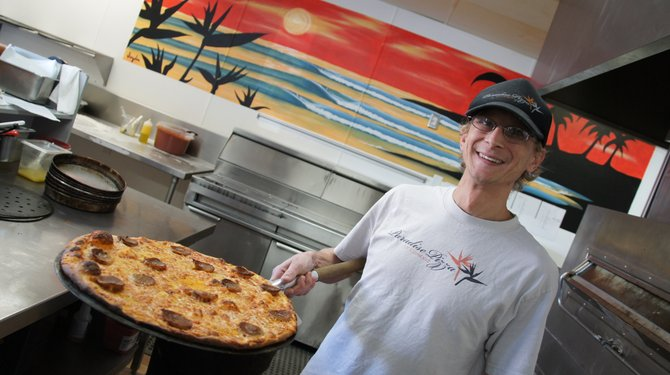 Pizza shop owner Mychal Dourson.  Photo Weatherston.
