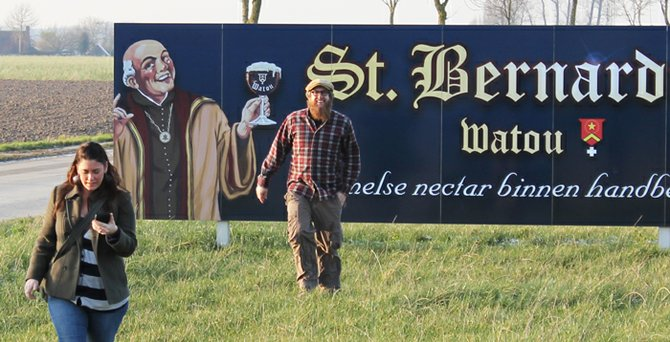 Scot Blair is all grins after wife, Karen, shoots his photo against a billboard for Belgium's Brouwerij St. Bernardus.