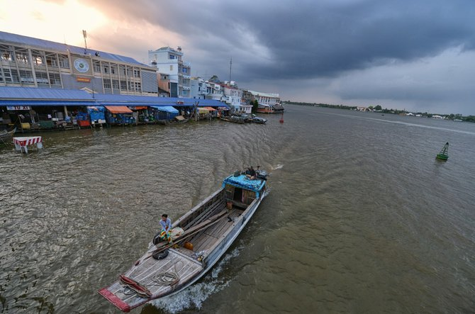 I just traveled back to Vietnam for a second time. While in the small town of Vinh Long, I took a picture of this merchant boat cruising up the Mekong Delta after a long day.