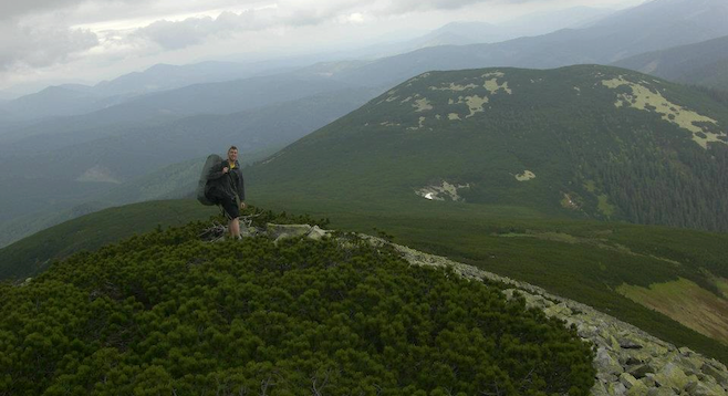 At the summit: a view of Eastern Europe's Carpathian Range stretching toward the horizon.