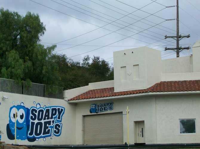 Car wash closed in National City on a rainy day.