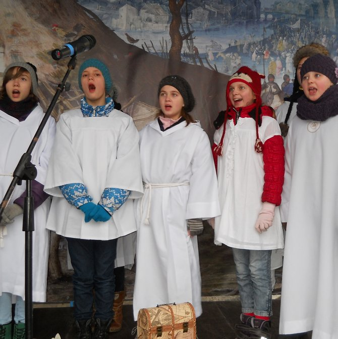 School Choir Christmas Carols in Poznan (the final scene in the Old Market Square eastern side in front of City Hall). Despite the rainy day on 6 January, the Three Kings Parade (crowds of people) started from Liberty Square. On the way to the Old Market Square there were the following biblical scenes: scene with angels and devils, scene of legionnaires, and scene of Herod. The final scene was in the Old Market Square where the Kings gave gifts to the newborn Infant Jesus. The procession of the Magi is a colorful show with the public participation: this year in almost 90 Polish cities. It is aimed at every active participant to express the joy of Christmas, among other things, by singing most famous Polish Christmas carols on the march. In 2013 the parade was held under the theme: 'Christmas Carols - Better to Sing than to Listen, Better Together than Alone'.