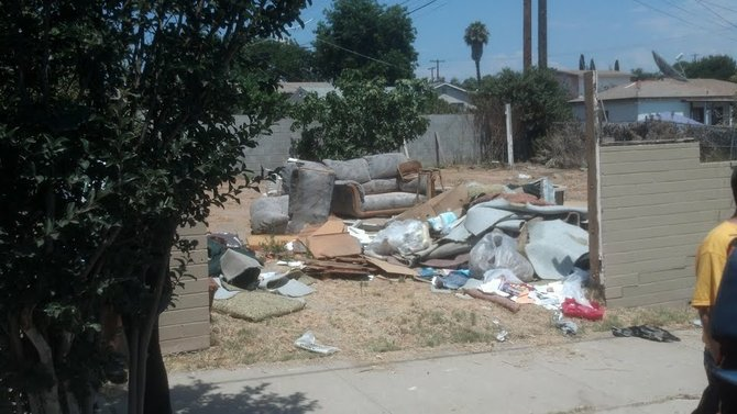 Trash piles up at a foreclosed property in the Mountain View neighborhood