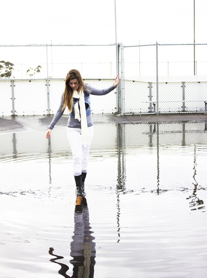 This is a photo taken at Clairmont high School in San diego. It was a very rainy day and part of the PE area was flooded, so we used this piece of wood to try and get across the deepest part of the puddle!