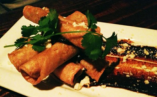 Sweet potato- and house-made chorizo stuffed taquitos with mole sauce