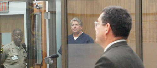 Michael T. Pines and prosecutor Romo in court.  Photo Weatherston.