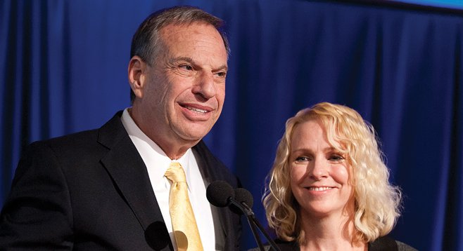 "Mayor Filner grins with San Diego's unwed ""first lady,"" Bronwyn Ingram"