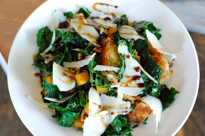 Tuscan kale salad dressed with sherry and balsamic vinegars and tossed with Crow's Pass Tahitian squash, fried ciabatta, hazelnuts and Parmesan