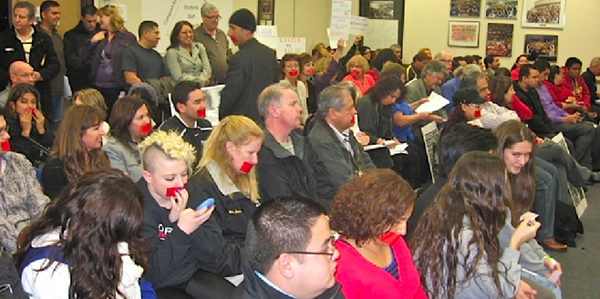 At the January 28 board meeting, members of the public placed tape over their mouths to suggest their voices in district matters meant nothing to trustees.