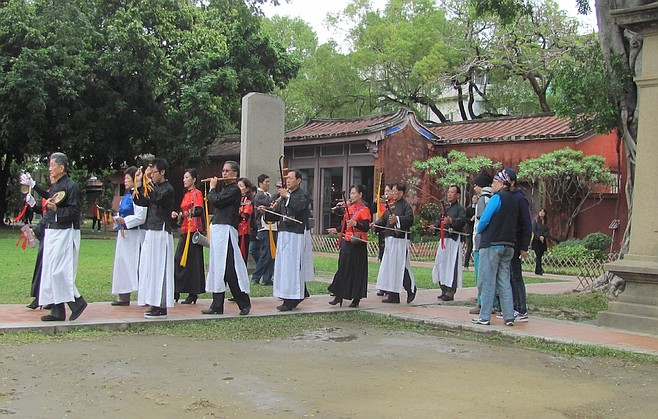 Traditional procession at the Tainan Confucius Temple.