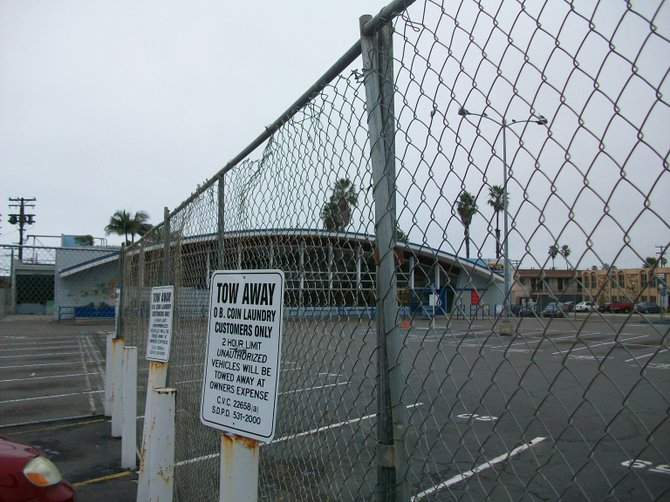 "Fenced off Apple Tree Market parking lot in OB. It looks ""ghetto!"""
