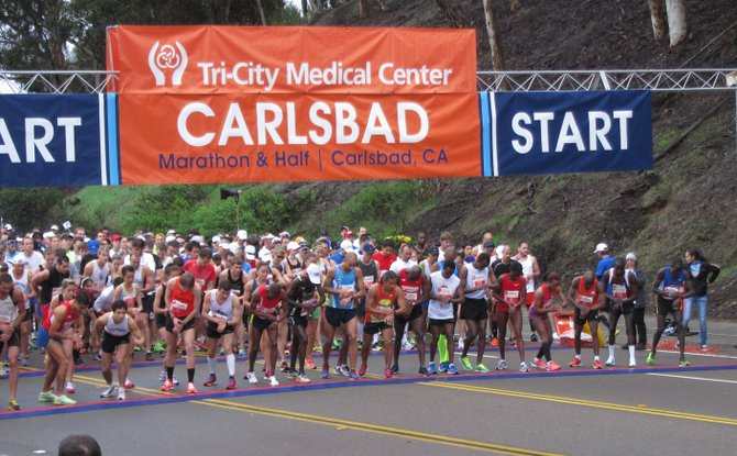 Synchronizing their watches, the elite runners from the half marathon in Carlsbad.