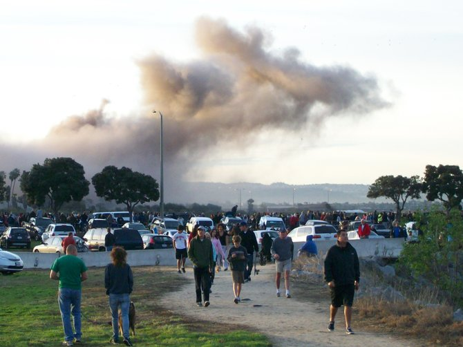 People make a quick getaway from watching the South Bay Power Plant implode in Chula Vista.