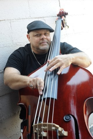 Bassman Brandino sets up at Seven Grand Wednesday night.