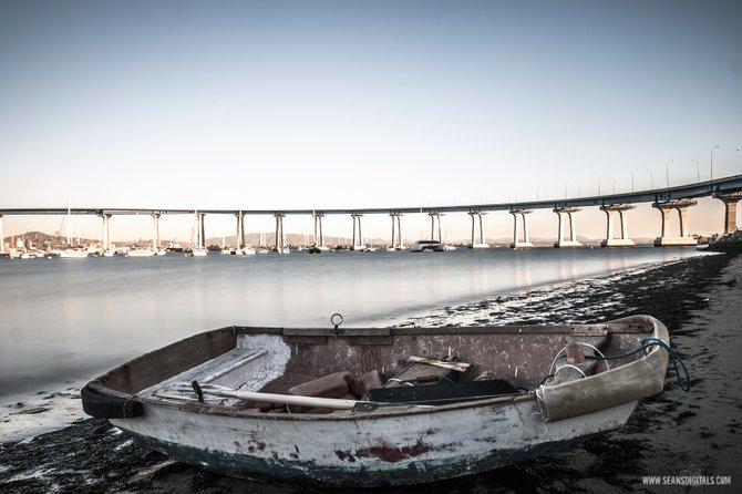 An abandon row boat sits quietly on the bay shore in Coronado.