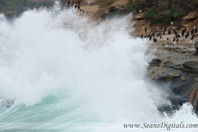 Big waves crash against the rocks of La Jolla