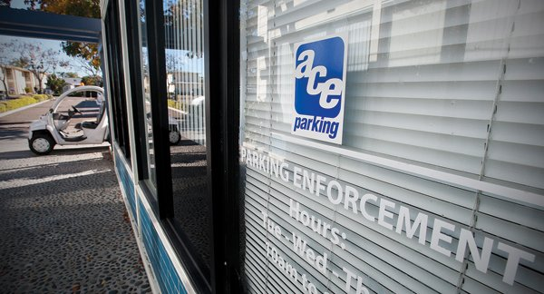"""Parking enforcement,"" reads the window at Ace Parking's downtown Chula Vista storefront. But can a private company enforce laws?"
