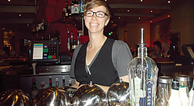Bartender Bek created the Flower Drum Song, a cocktail using St. Germain, sake, soju, and lemon.