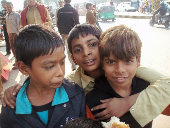 For many in Delhi, including these street kids, the sight of a Westerner equals money.