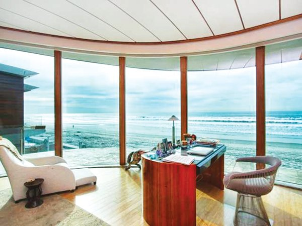 Most areas of the house, including this office space, feature sweeping ocean views.