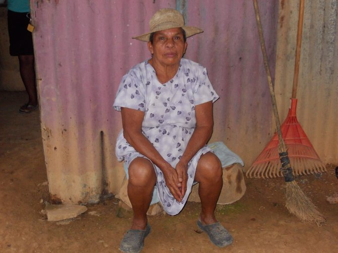 Abuelita awaits dinner in the small community of La Chumicosa in Coclé, Panama. She hand made the sombrero she is wearing.