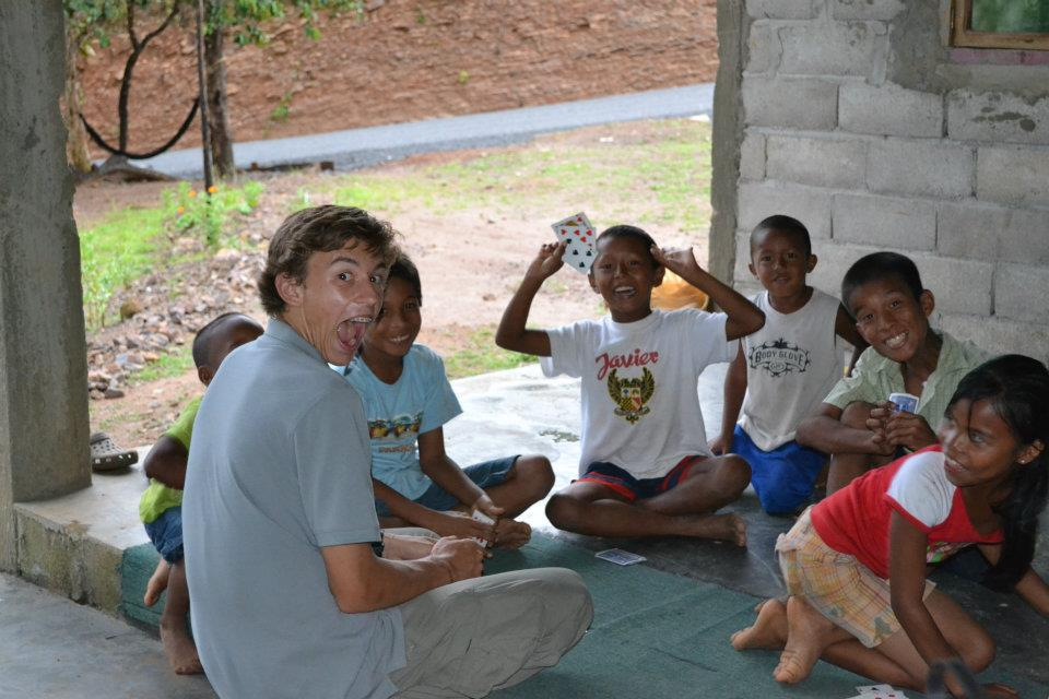 Me playing cards with some local kids in Hijo de Dios. Cocle, Panama