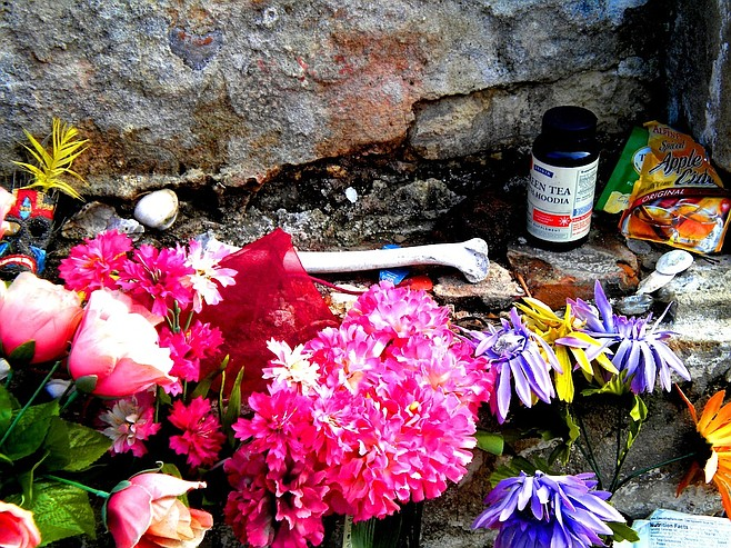 Some of the offerings at famed voodoo priestess Marie Laveau's tomb.