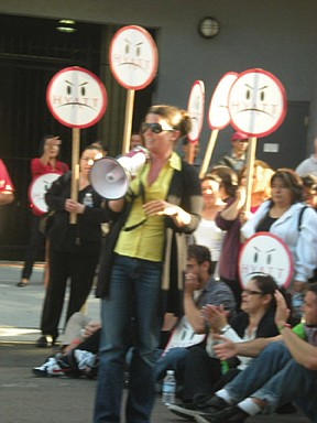 Brigette Browning (with megaphone)