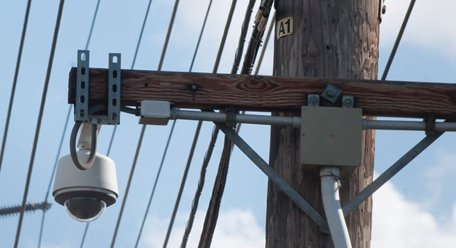 SDG&E mounted this camera to monitor property it owns. At least one neighbor worries that his property could be monitored as well. - Image by Alan Decker