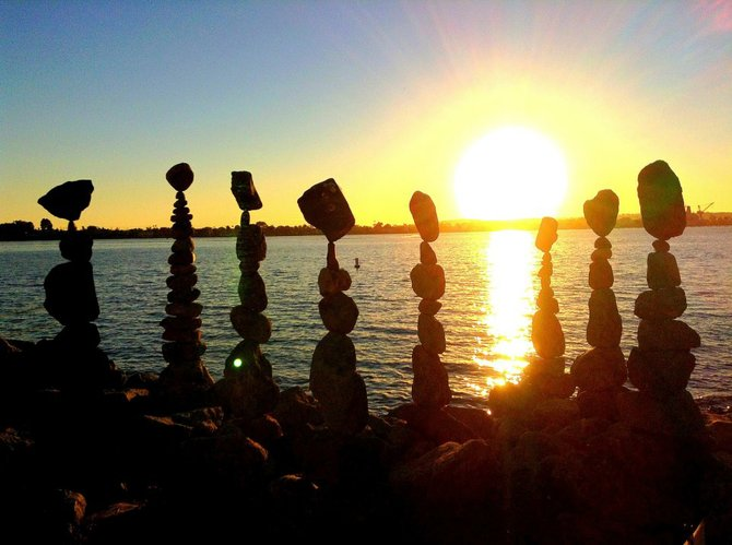 The sun sets behind the stacked rocks at Seaport Village.