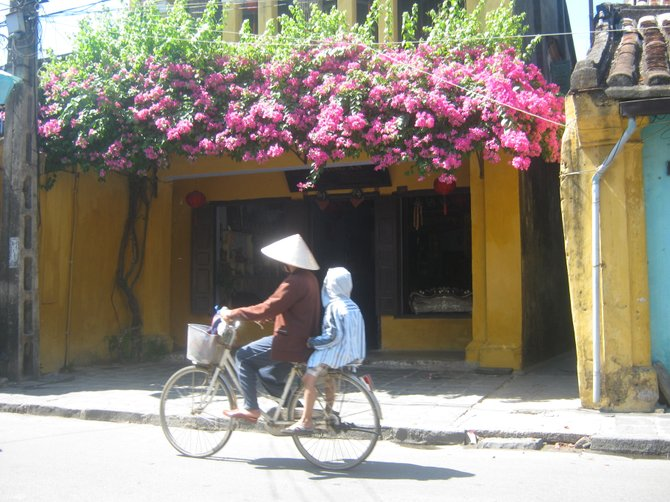 Bicycling in Hoi An, Vietnam -the primary form of transportation for many local families