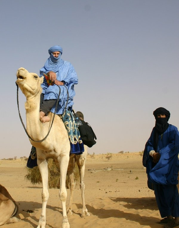 Author riding in Sahara
