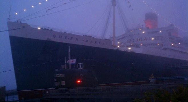 The stately Queen Mary in the fog at Long Beach.