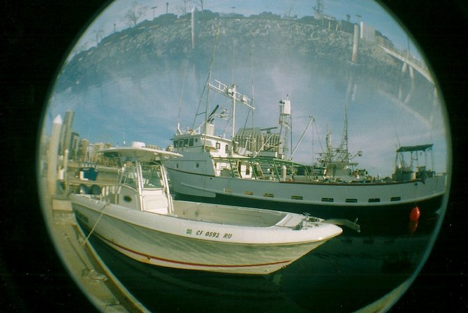 This is a picture I took using multiple exposures in the harbor on my fisheye camera using 35mm film.