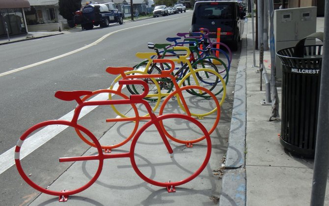 The Hillcrest bike corral outside Filter Coffee House is appropriate, with its bright rainbow colors.
