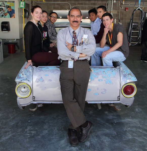 Leonardo Zarate with his students at Morse High School's three-million-dollar facility for auto-body repair and refinishing