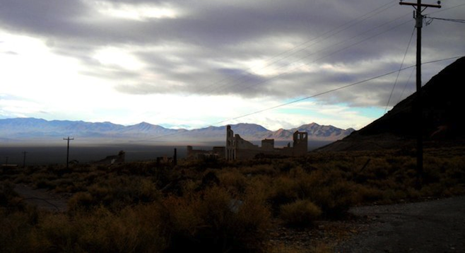 View of Rhyolite and surrounding desert from the town's abandoned gold mine.