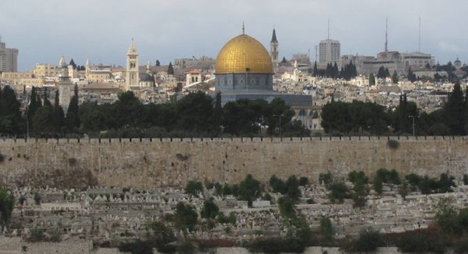 Jerusalem: walls of the Old City and the gold-capped Islamic Dome of the Rock.