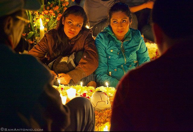 Storytelling at a gravesite in Xoxocotlan Cemetery