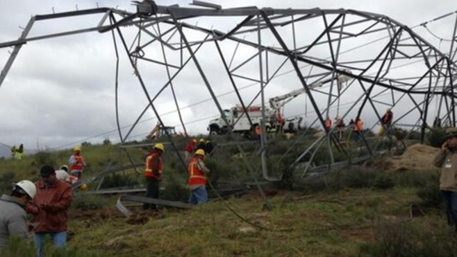 Downed transmission tower though to e the work of a thief (photo from El Mexicano)