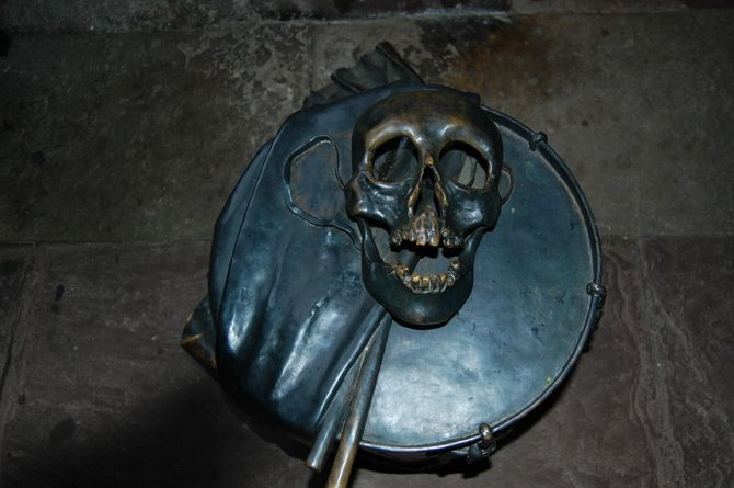 A sculptural reminder that the Grim Reaper comes to us all: A skull atop a drum in the courtyard of the Münster, Basel's nearly 1,000 year old church.