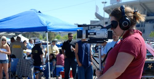 Director Gloria Moran and her handy Canon 3CCD at Qualcomm Stadium capturing the action of Lowriderfest, 2011.