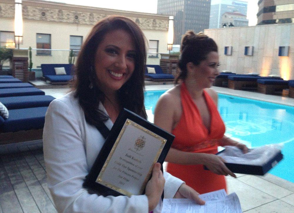 Jodi holding her award